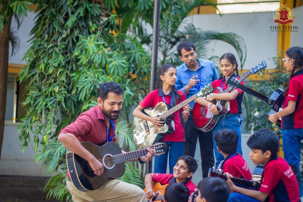guitar classes in Orchids school