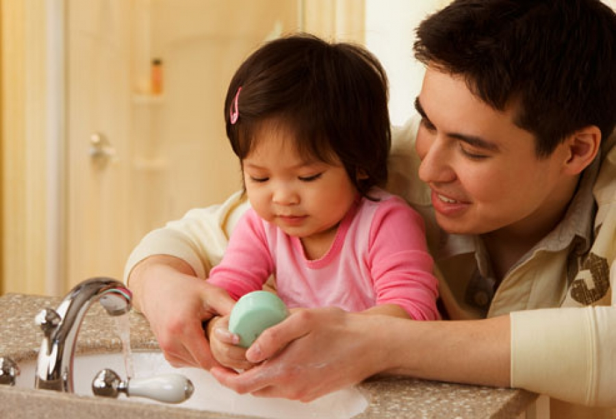 Hand Wash father is teaching to daughter