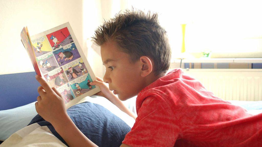 Child reading Comic book