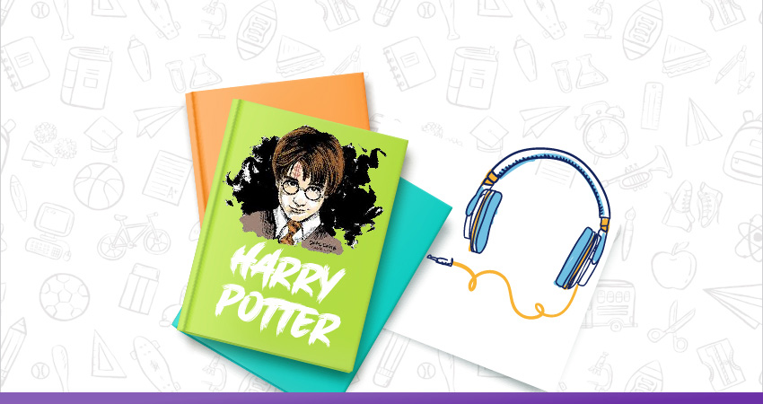 book and black headphone with trinket