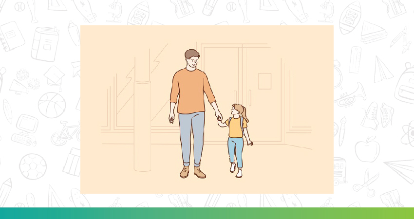 A child walking on a field holding hands with her parents