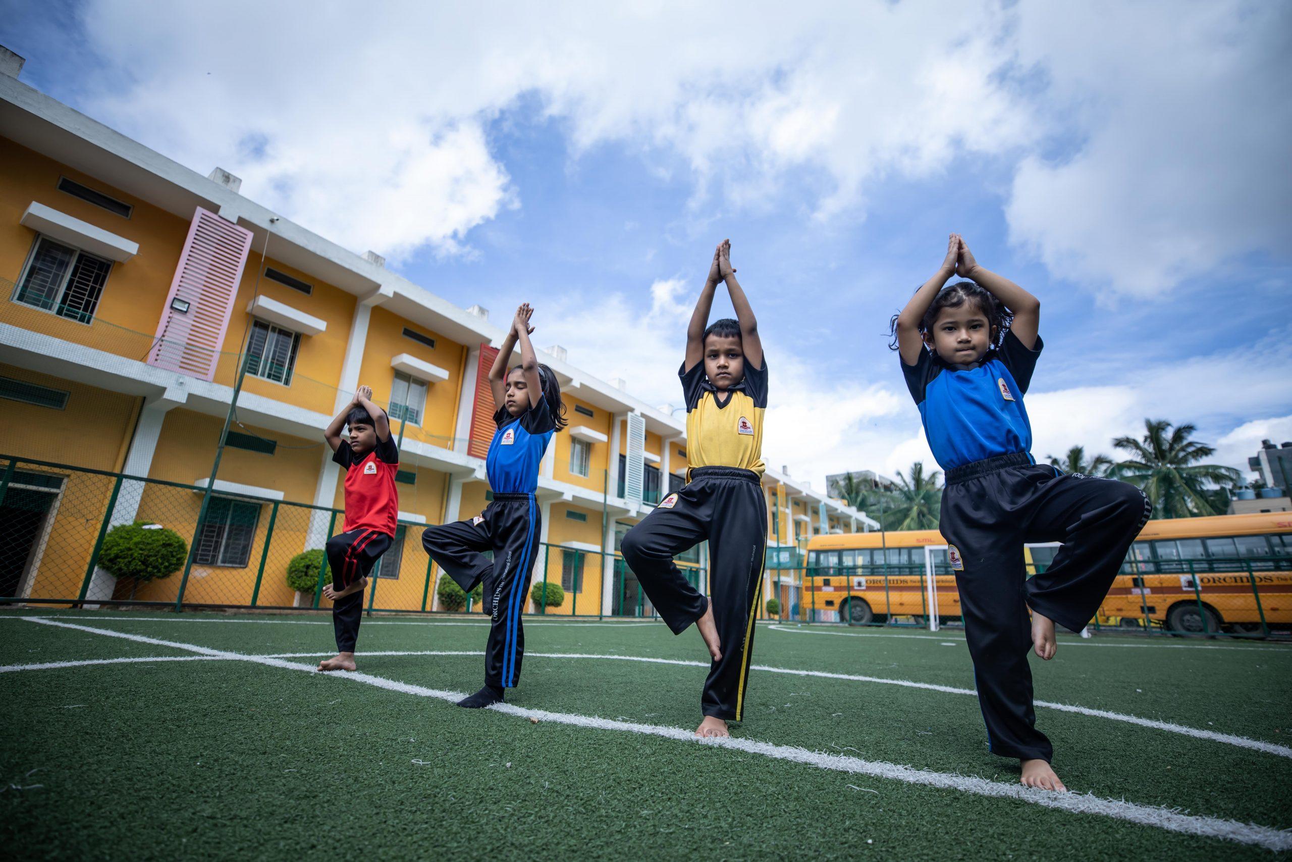 Benefits of yoga for kids -  help build self esteem - Orchids