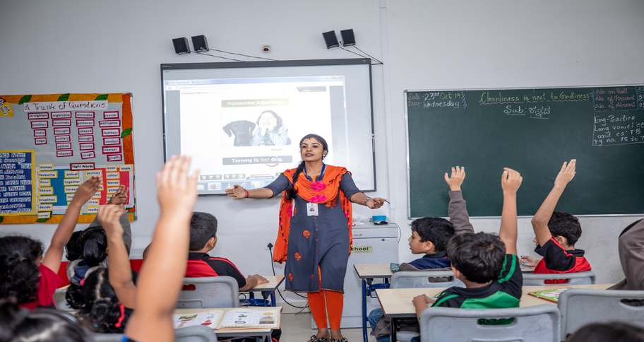 Students taught via computer in classroom to increase their participation in class - Orchids