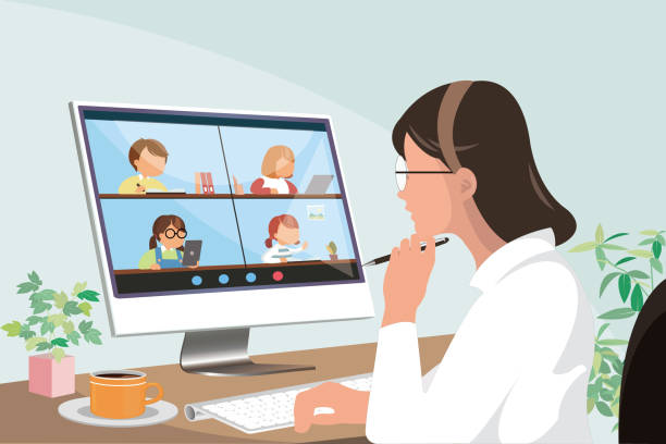 female elementary teacher using online education technology and device to teach students