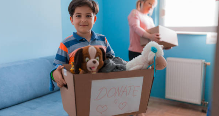 a kid donating his things