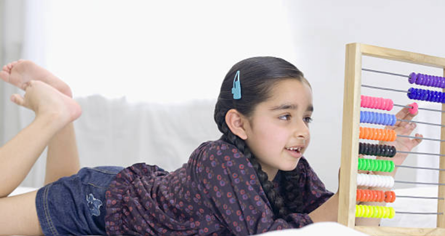 a girl playing with abacus