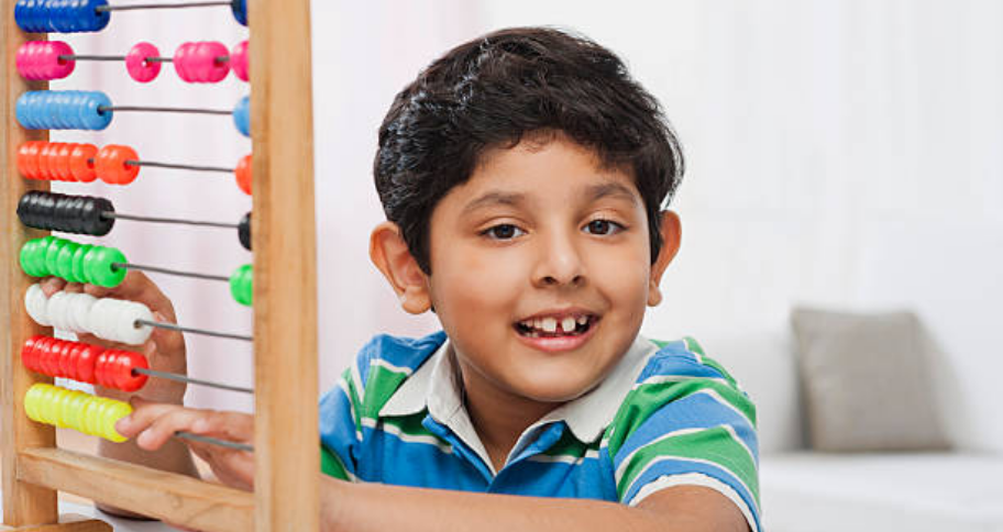 a child learning the Benefits of Abacus