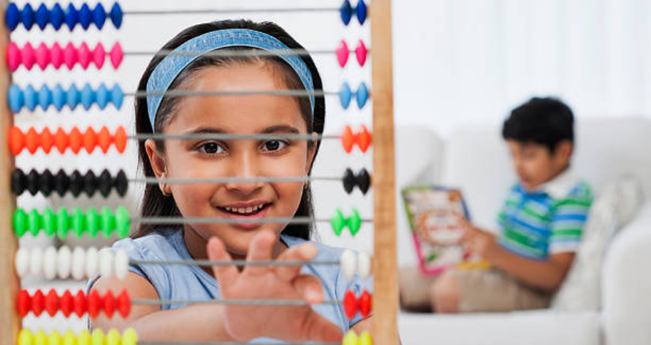 a child learning Benefits of Abacus