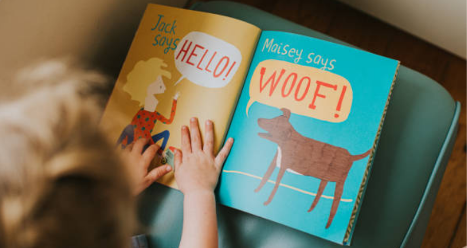 a child learning through a picture book