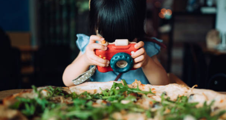 a child taking picture of the food