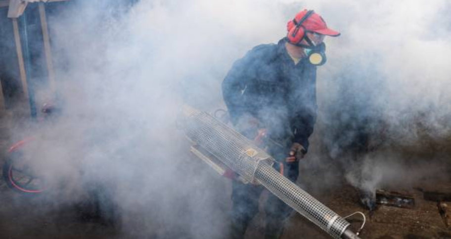 a man fumigating streets to prevents infectious diseases