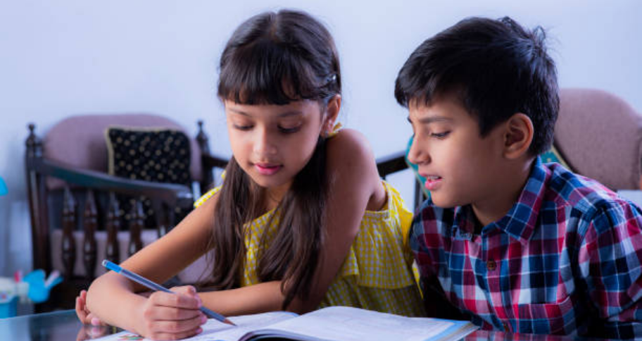 two kids sitting down to study