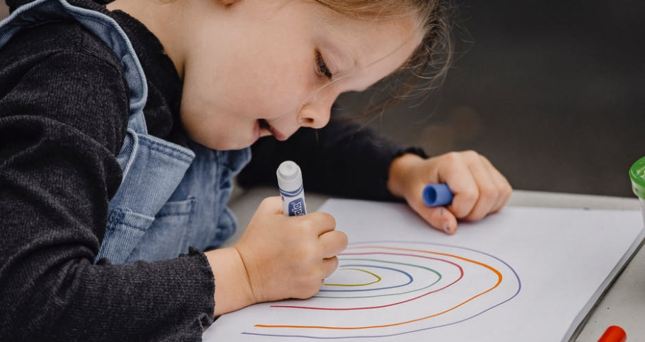 a boy drawing on a paper