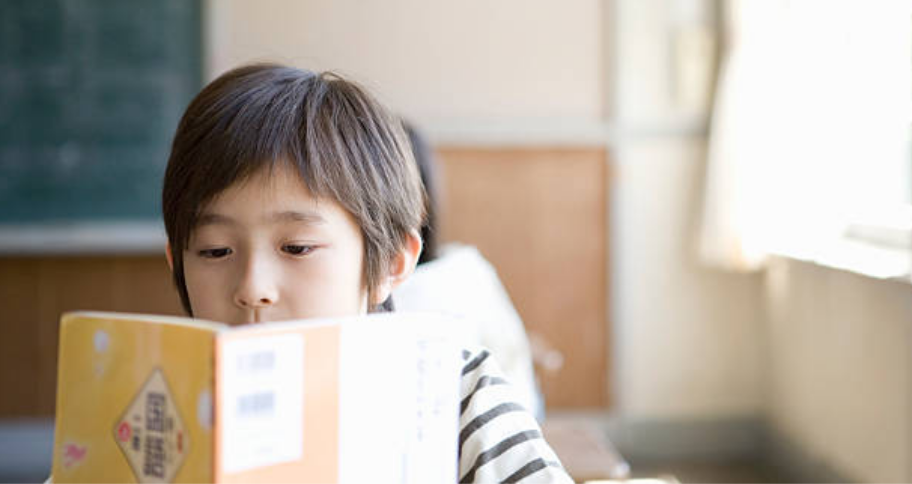 a boy trying to learn a new language