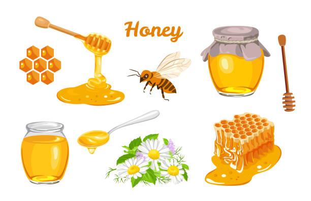 Honeycombs, bee, honey in glass  jar, wooden honey dipper, honey in metal spoon and flowers