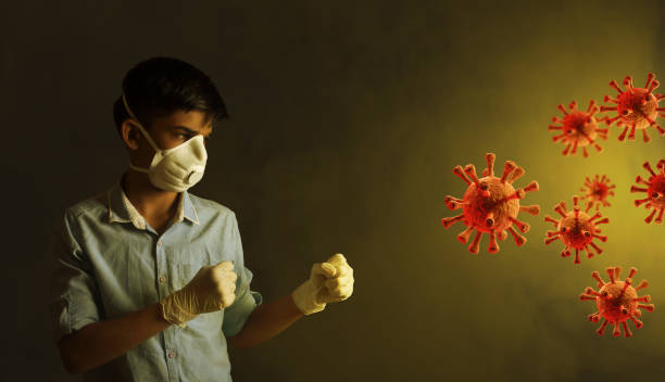 young Indian boy wearing protective mask and fighting against the coronavirus