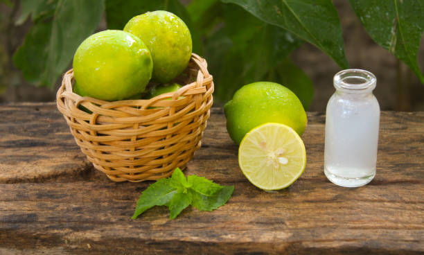 lemons and lemon juice in a small glass jar on a wooden table