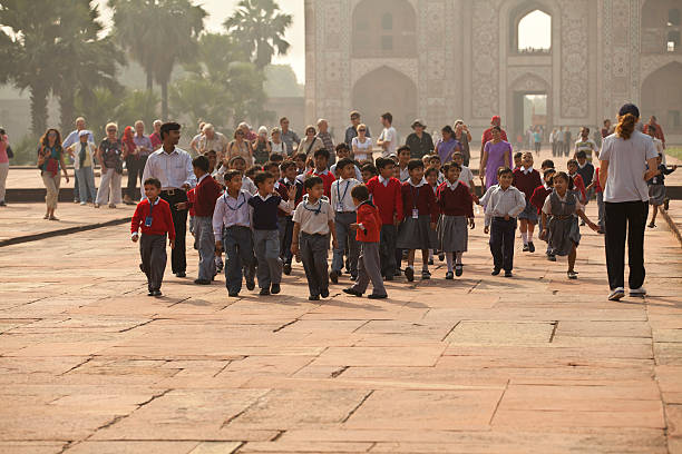 A group of school children on a field trip walking the grounds of the Tomb of Akbar the Great.