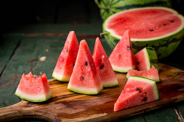 Watermelon sliced on wood