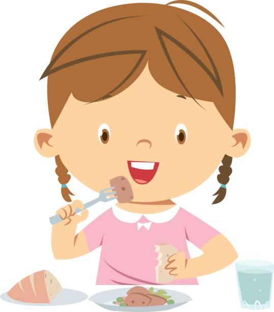 little girl eating meal