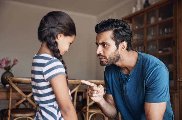 Shot of a father disciplining his daughter at home