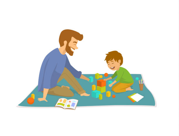 man and boy, father and son playing on floor at home developing games