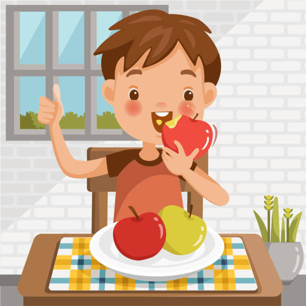 Boy eating apple.sitting at the table  eating fruit