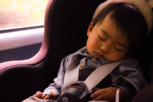 while traveling a boy fall asleep in the car